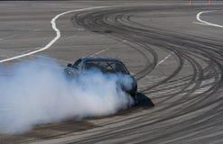 Drift car brand Nissan overcome turn track Royalty Free Stock Photo