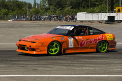 Drift car brand Nissan overcome turn track Stock Photography