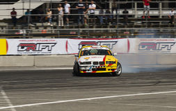 Drift car overcome turn track. Lviv, Ukraine - Juny 6, 2015: Unknown rider on the car brand BMW overcomes the track in the championship of Ukraine drifting in royalty free stock image