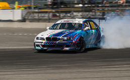 Drift car overcome turn track. Lviv, Ukraine - Juny 6, 2015: Unknown rider on the car brand BMW overcomes the track in the championship of Ukraine drifting in stock photography