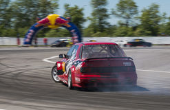 Drift car overcome turn track. Lviv, Ukraine - Juny 6, 2015: Unknown rider on the car brand Ford overcomes the track in the championship of Ukraine drifting in royalty free stock image