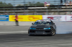 Drift car overcome turn track. Lviv, Ukraine - Juny 6, 2015: Unknown rider on the car brand Nissan overcomes the track in the championship of Ukraine drifting in stock image