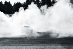 Drift car show at the Bucharest Auto Show. Sport car wheel drifting, surrounded by smoke. BUCHAREST, ROMANIA - APRIL 4 2015: Drift car show at the Bucharest Auto royalty free stock photography