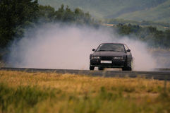 Drift car in turn. BMW drift special throwing clouds of smoke Royalty Free Stock Images