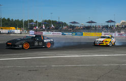Drift cars brand Nissan and BMW overcome turn track Stock Photo