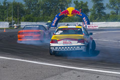 Drift cars brand Nissan and BMW overcome turn track Royalty Free Stock Photography