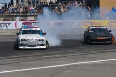 Drift cars brand Nissan and BMW overcome turn track royalty free stock image