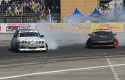 Drift cars brand Nissan and BMW overcome turn track royalty free stock photos