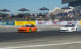 Drift cars brand Nissan overcome turn track Stock Photos