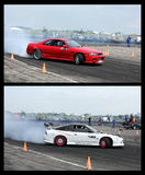 Drift cars performing Stock Images
