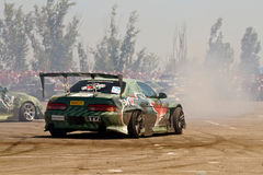 Drift cars team Round-X enters the bend with slip Stock Photos