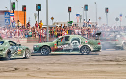 Drift cars team Round-X enters the bend with slip Royalty Free Stock Photos