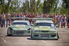 Drift cars team Round-X go near a short distance Stock Image