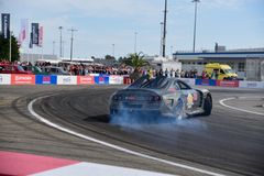 Sport car drift in front of the audience. royalty free stock photography