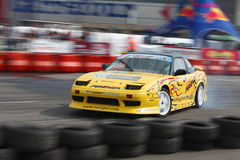 Drift King of Europe championship-Cluj Napoca. Panning image of a car during the Drift King of Europe championship in Cluj Napoca,Romania between 19-20.09.2009 Royalty Free Stock Images