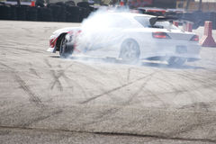 Drift Racing. Car in action with smoking tyres Royalty Free Stock Images