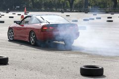 Drift Racing. Car in action with smoking tyres Royalty Free Stock Photo