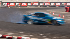 Drift racing car motion blur Stock Images