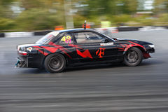 Drift racing car. Tyumen, Russia - May 31, 2014: A drift racing car in action with smoking tires in hairpin bend at Russian Drift Series Ural 2014 Stock Photos