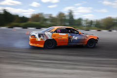 Drift racing car. Tyumen, Russia - May 31, 2014: A drift racing car in action with smoking tires in hairpin bend at Russian Drift Series Ural 2014 Royalty Free Stock Photography