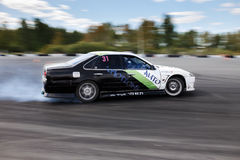 Drift racing car. Tyumen, Russia - May 31, 2014: A drift racing car in action with smoking tires in hairpin bend at Russian Drift Series Ural 2014 Royalty Free Stock Images