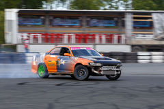 Drift racing car. Tyumen, Russia - May 31, 2014: A drift racing car in action with smoking tires in hairpin bend at Russian Drift Series Ural 2014 Stock Photography