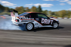 Drift racing car. Tyumen, Russia - May 31, 2014: A drift racing car in action with smoking tires in hairpin bend at Russian Drift Series Ural 2014 Stock Images
