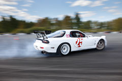 Drift racing car. Tyumen, Russia - May 31, 2014: A drift racing car Mazda RX-7 in action with smoking tires in hairpin bend at Russian Drift Series Ural 2014 Stock Images