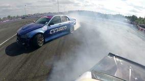 Drift racing outdoors, near collision