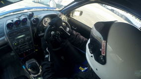 Drift racing outdoors, view of the car cabin stock footage