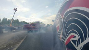 Drift racing outdoors, view from the rear wheel stock video footage