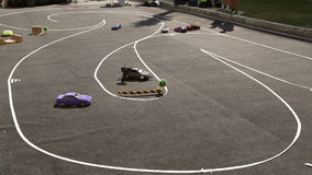 Drift RC models, radio control drift. Two small RC cars going around the track stock video