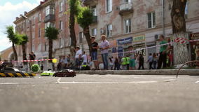 Drift RC models, radio control drift. Two small RC cars going around the track on June 25, 2016 in Novokuibishevsk/Samara region/Russia stock footage