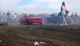 Drifting bmw hide in smoke stock images