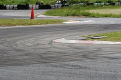 Drift Slalom. Slalom motorsport circuit used for drift competitions. The tarmac is covered with tyre marks. Focus is on the first corner apex kerb royalty free stock photos