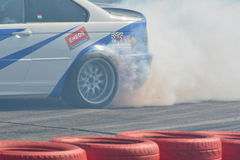Drift smoke. Drift show at the airport, Tököl, Hungary. Photo taken to: April 12th, 2015 Stock Photos