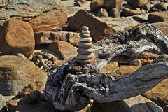 Drift Wood with a Zen Monument, in the Dawn Sunlight royalty free stock image