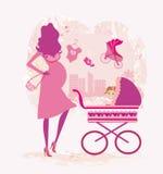 Driftig gravid kvinna en stroller Royaltyfri Bild