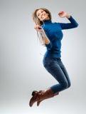 driftig musikspelarekvinna arkivfoto
