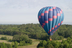 Drifting. Aerial view of a hot air balloon Royalty Free Stock Photos
