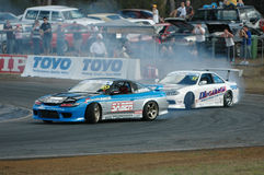 Drifting. Image taken of two drifters battling it out on the drift track at the queensland raceway in australia Stock Photography