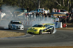 Driving. Image taken of two drivers battling it out on the race track at the queensland raceway in australia Stock Photo