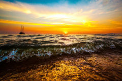 Drifting boat in the ocean on a sunset. Drifting boat in the sea on a sunset royalty free stock image