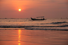 Drifting boat on a sunset Stock Photography