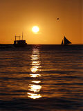Drifting boat on a sunset Stock Photos