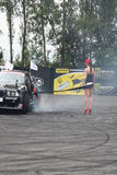 Drifting car and girl Stock Image