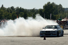 Drifting car. Image of drift racing at the event night of performance in Hungary, on 06.07.2014 Royalty Free Stock Photo