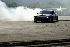 Drifting car. Image of drift racing at the event night of performance in Hungary, on 06.07.2014 Stock Photography