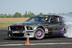 Drifting car. Image of drift racing at the event night of performance in Hungary, on 06.07.2014 Stock Photos