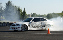 Drifting car. Image of drift racing at the event night of performance in Hungary, on 06.07.2014 Royalty Free Stock Photos